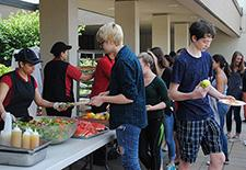 NCHS Food Service serving picnic foods to NCHS students