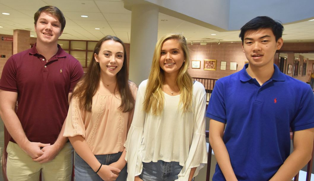 New Canaan High School seniors Conor West, Erin Spiess, Natasha Tchir, and Daniel Lu (pictured, left