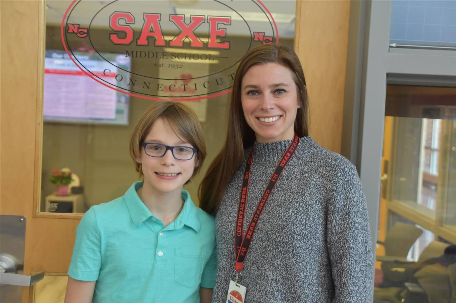 Saxe 6th grader Rowan Richey Elliot pictured with Saxe Social Studies teacher Christina Fulco.