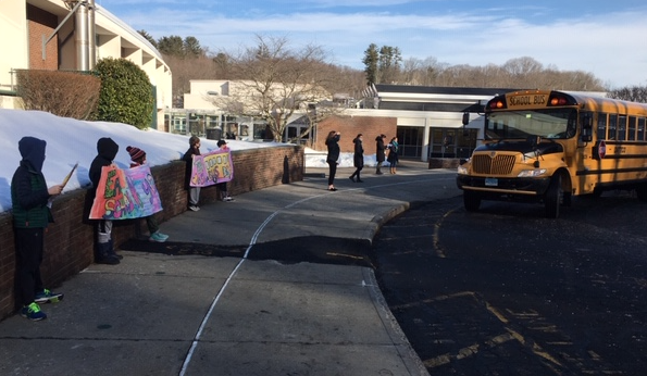 photo of students with bus driver appreciation posters
