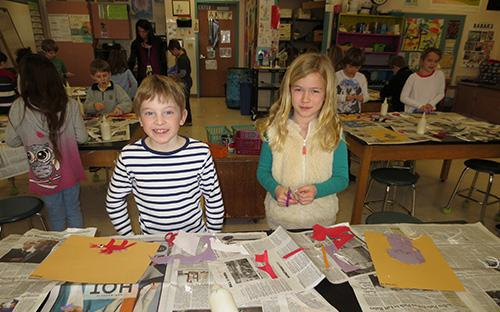 Two West students working on art project.