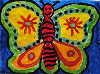 East School artwork of happy butterfly in bright colors.