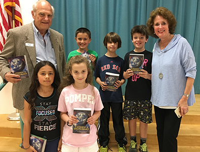image of students with dictionaries from the New Canaan Rotary Club